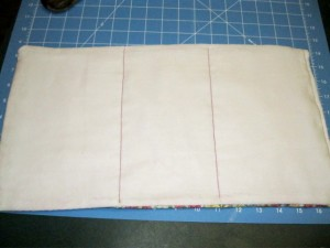 Sew two lines to devide cloth into three parts